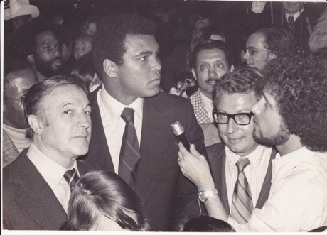 ALI AND GENE KELLY AT A PRESS CONFERENCE