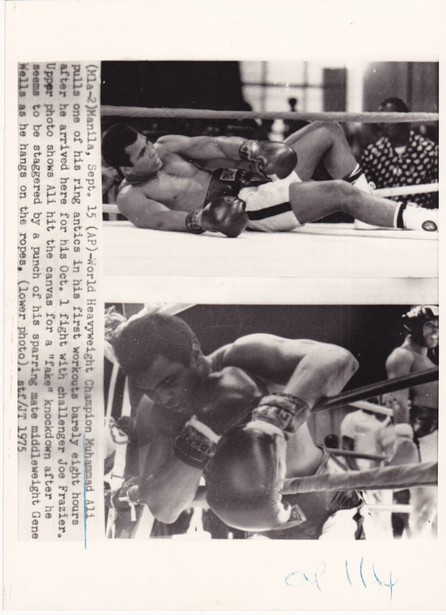 ALI FAKES A KNOCK DOWN WIRE PHOTO