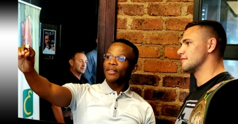 CEO of BSA Tsholo checks out Kevin Leren's IBO Ring - African Ring