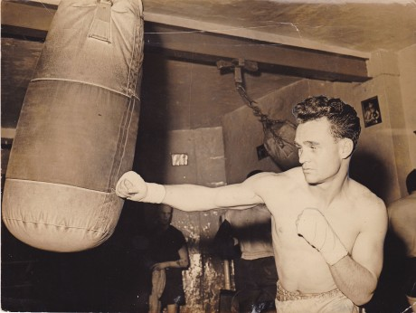 DENNIS ADAMS ON THE PUNCH BAG